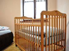 Bedroom with a baby cot